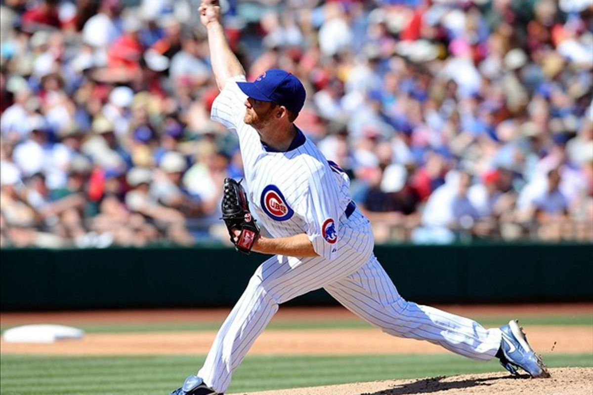 Mesa, AZ, USA; Chicago Cubs starting pitcher Ryan Dempster throws during the second inning against the Arizona Diamondbacks at Hohokam Stadium. Credit: Christopher Hanewinckel-US PRESSWIRE