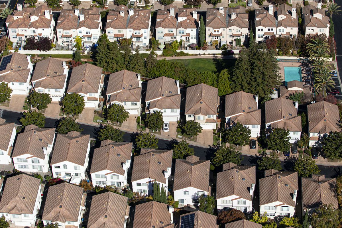 Tightly packed rows of mostly identical houses, seen from above.