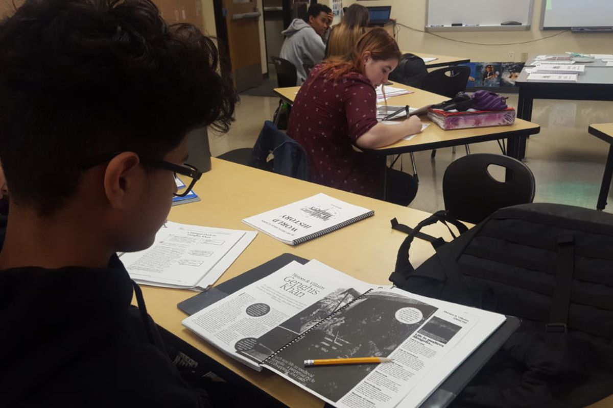 Students in a social studies class at Bear Creek High School in Jeffco Public Schools read about Genghis Khan.