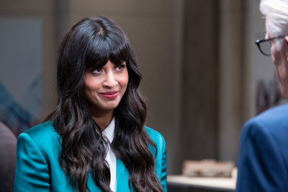 """Tahani (Jameela Jamil) smiles at Michael (Ted Danson)  in a screenshot from The Good Place season 4, episode 13, """"Whenever You're Ready"""""""