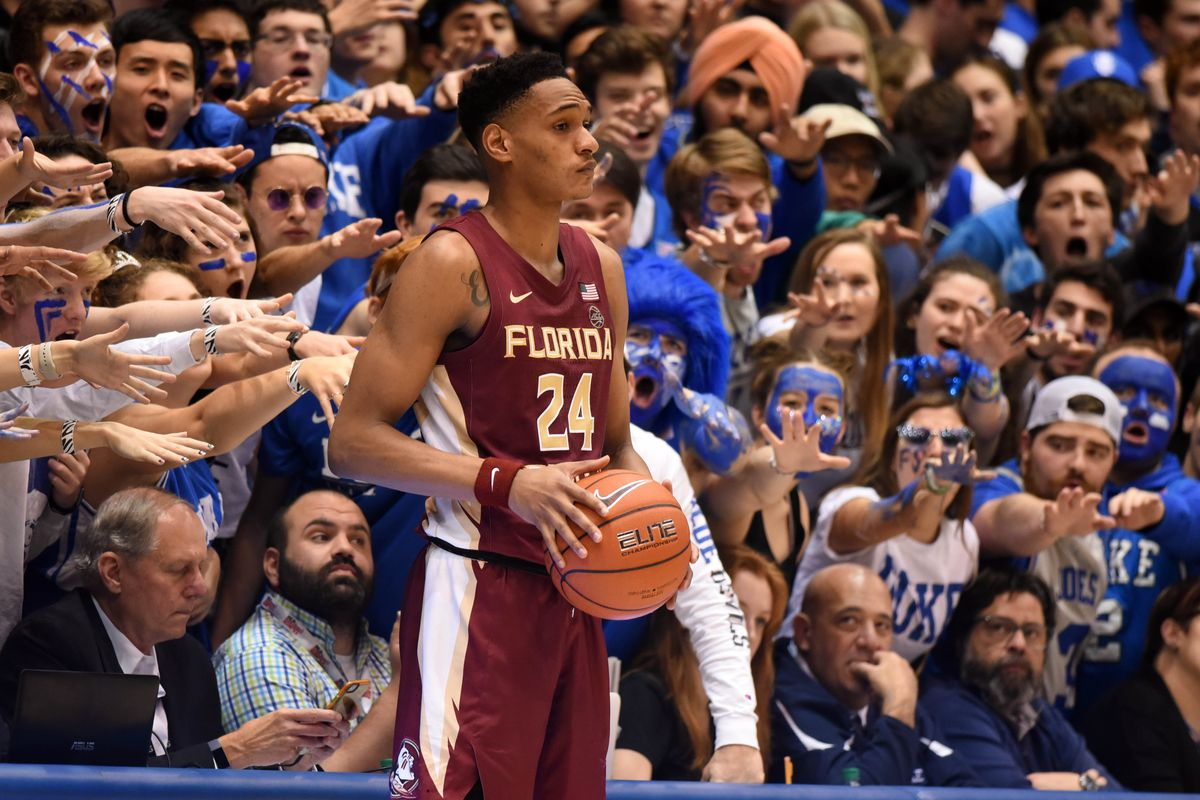 Duke Blue Devils fans harass Florida State Seminoles guard Devin Vassell as he attempts to inbound the ball during the second half at Cameron Indoor Stadium. Duke won 70-65.