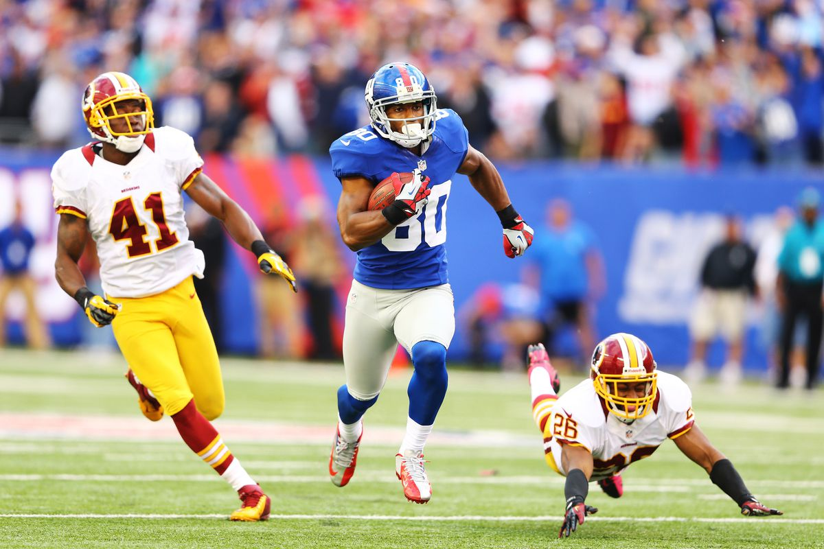 Victor Cruz races down field for a game-winning 77-yard touchdown on Sunday.