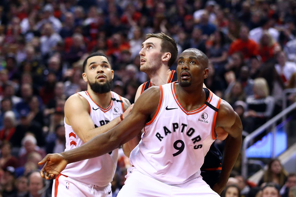 Fred VanVleet and Serge Ibaka of the Toronto Raptors battle for a rebound with Luke Kornet of the Chicago Bulls during the first half of an NBA game at Scotiabank Arena on February 02, 2020 in Toronto, Canada.