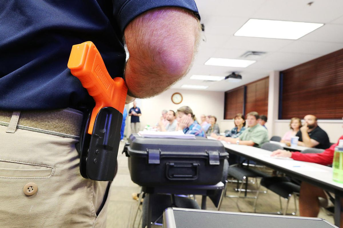 """Clark Aposhian teaches during a concealed firearm permit class """"Safe to Learn, Safe to Teach"""" in South Jordan Friday, Oct. 16, 2015. The classroom training was reserved for educators free of charge."""