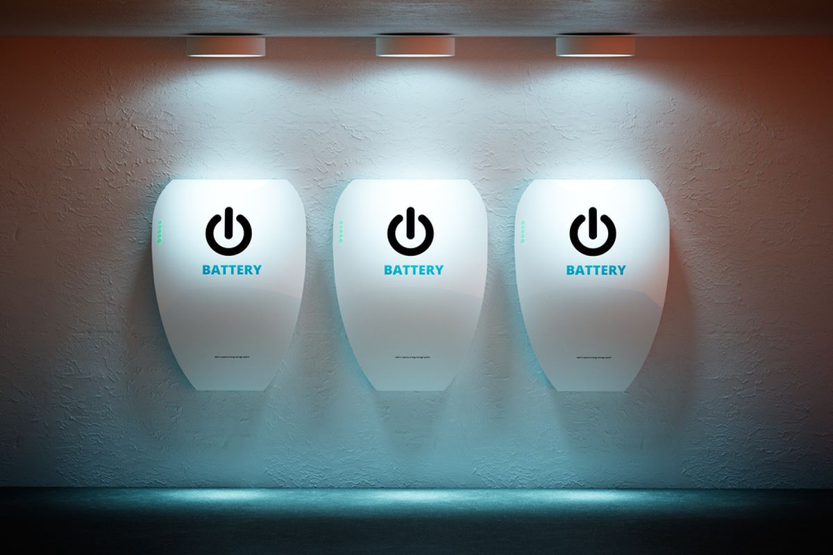 """Three wall batteries on a wall, each with the computer power symbol and the word """"battery."""""""