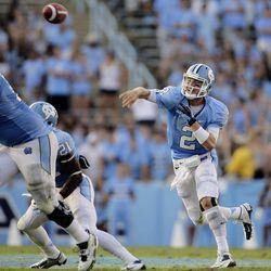 North Carolina quarterback Bryn Renner (2) passes as Travis Bond (76) and Romar Morris (21) block against East Carolina during the second half of an NCAA college football game in Chapel Hill, N.C., Saturday, Sept. 22, 2012. North Carolina won 27-6.