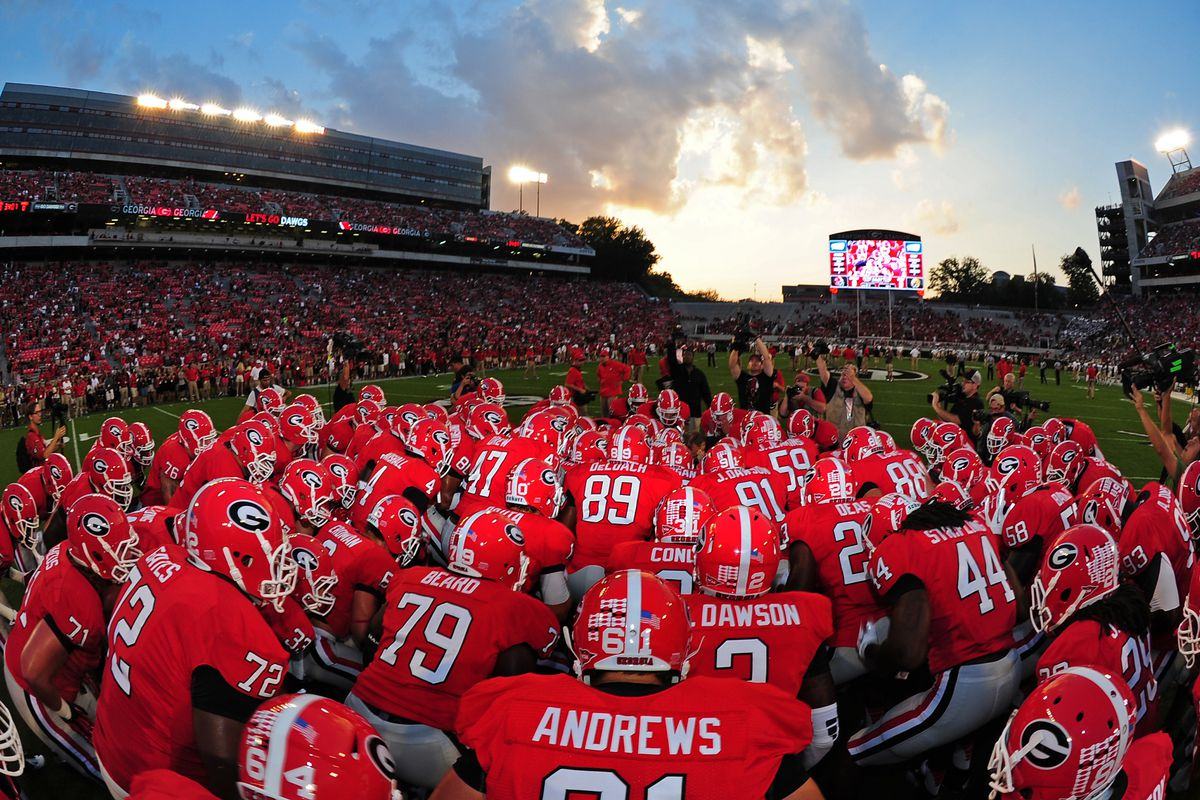 ATHENS, GA - SEPTEMBER 22: Members of the Georgia Bulldogs huddle before the game against the Vanderbilt Commodores at Sanford Stadium on September 22, 2012 in Athens, Georgia. (Photo by Scott Cunningham/Getty Images)