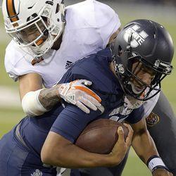 Idaho State defensive back Atoa Fox tackles Utah State quarterback Jordan Love during an NCAA college football game Thursday, Sept. 7, 2017, in Logan, Utah. (Eli Lucero/Herald Journal via AP)