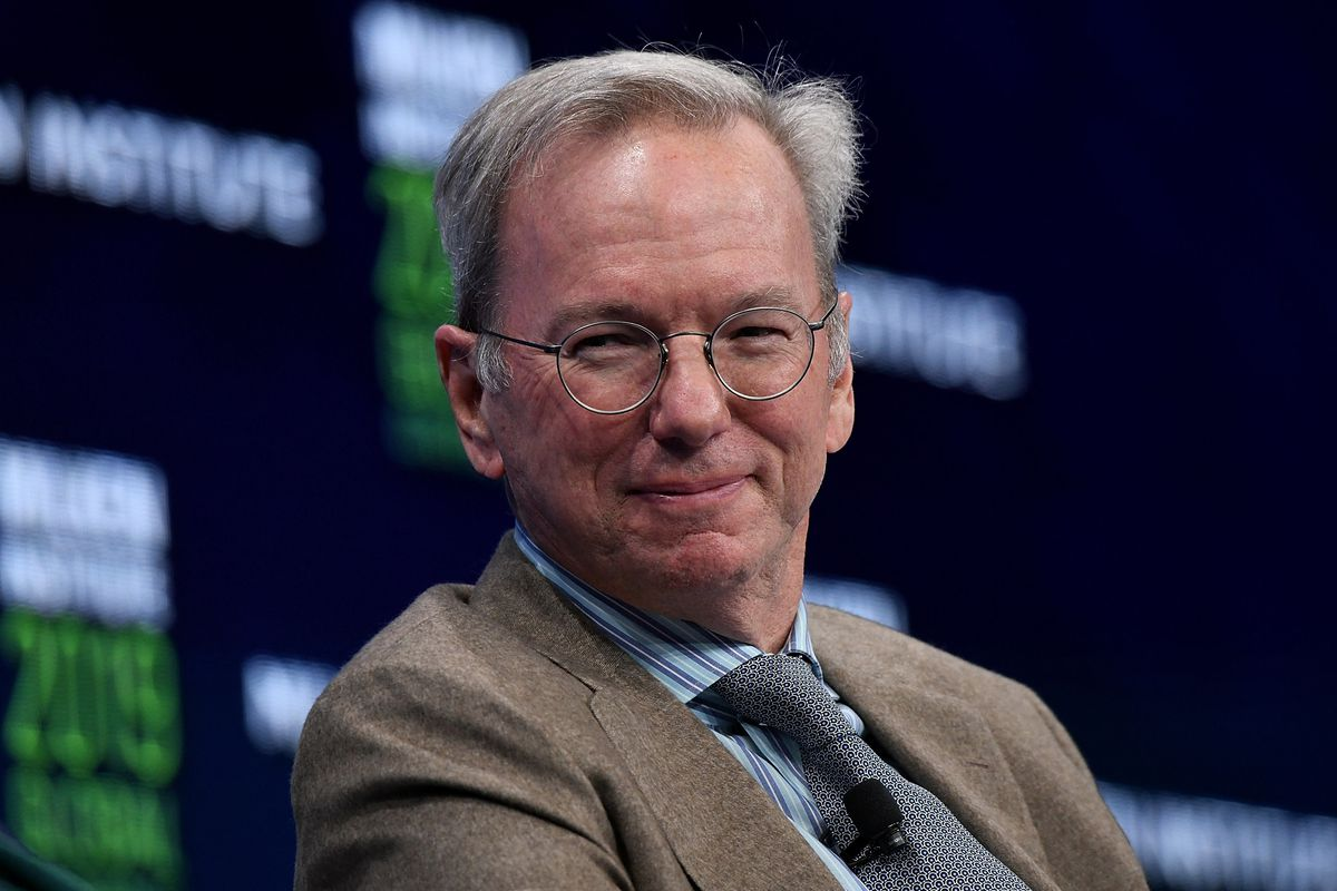 Eric Schmidt seated onstage at a conference.