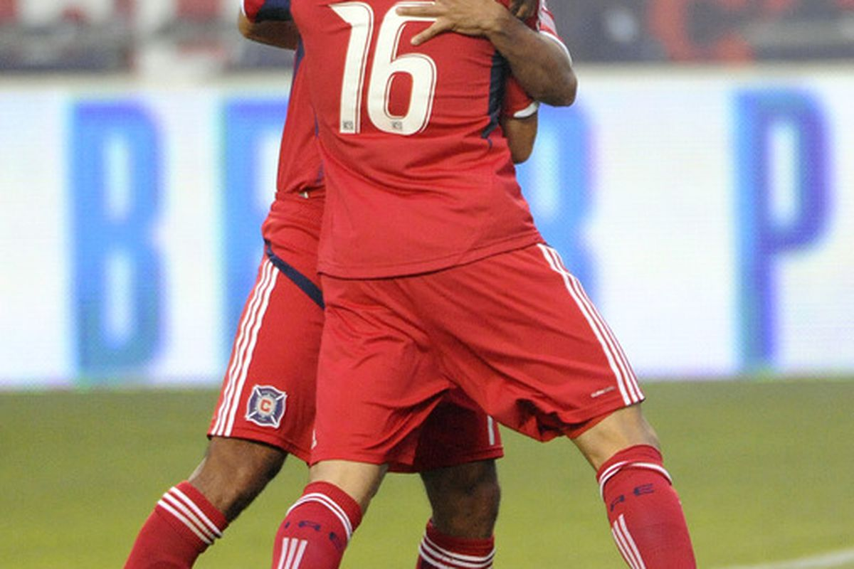 He's never boring: Marco Pappa celebrates his 2nd minute goal against the Columbus Crew with Pavel Pardo. The Fire ended up knocking off their Eastern Conference rivals by a 2-1 scoreline.