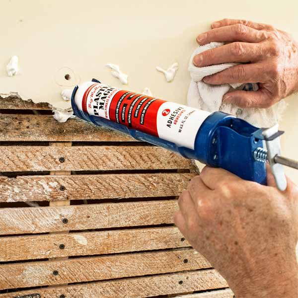 Person uses plaster magic on to repair lath and plaster.