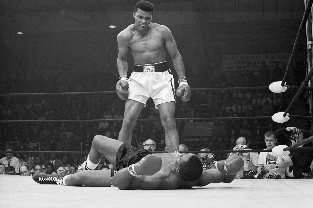 Muhammad Ali taunting Sonny Liston after knocking him down