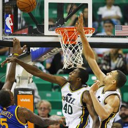 Utah's Jeremy Evans and teammate Rudy Gobert defend a shot by Warriors' Marreese Speights as they Utah Jazz and the Golden State Warriors play Tuesday, Oct. 8, 2013 in preseason action at Energy Solutions arena in Salt Lake City.