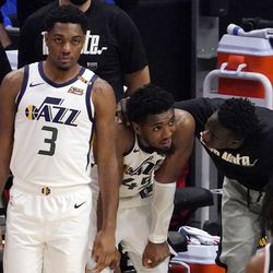 Utah Jazz guard Donovan Mitchell, center, is consoled at the bench as guard Trent Forrest, left, stands by during the closing seconds of the second half in Game 6 of a second-round NBA basketball playoff series against the Los Angeles Clippers Friday, June 18, 2021, in Los Angeles.