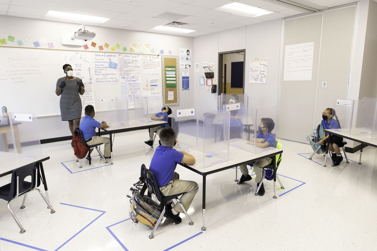 Students sit in a Texas classroom with COVID protections in place.