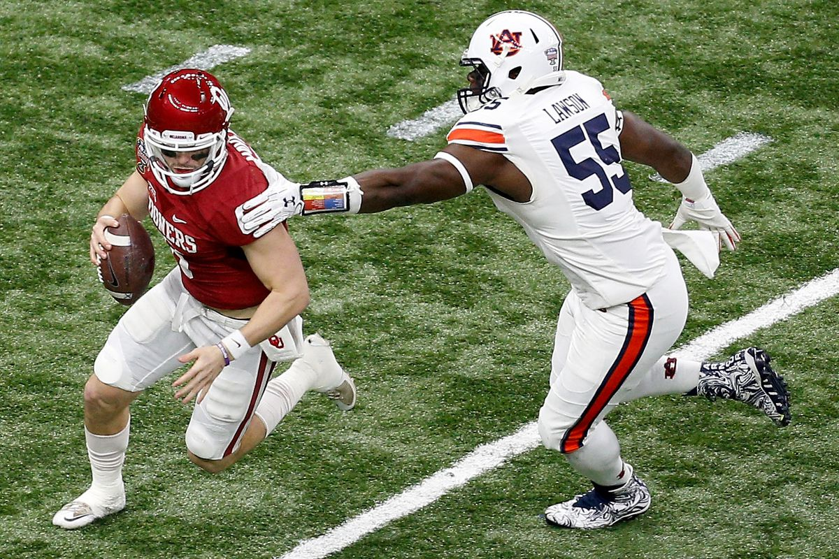 NEW ORLEANS, LA - Auburn Tigers outside linebacker Carl Lawson (55) gets a hand on scrambling Oklahoma Sooners quarterback Baker Mayfield (6) during the Allstate Sugar Bowl at the Mercedes-Benz Superdome.