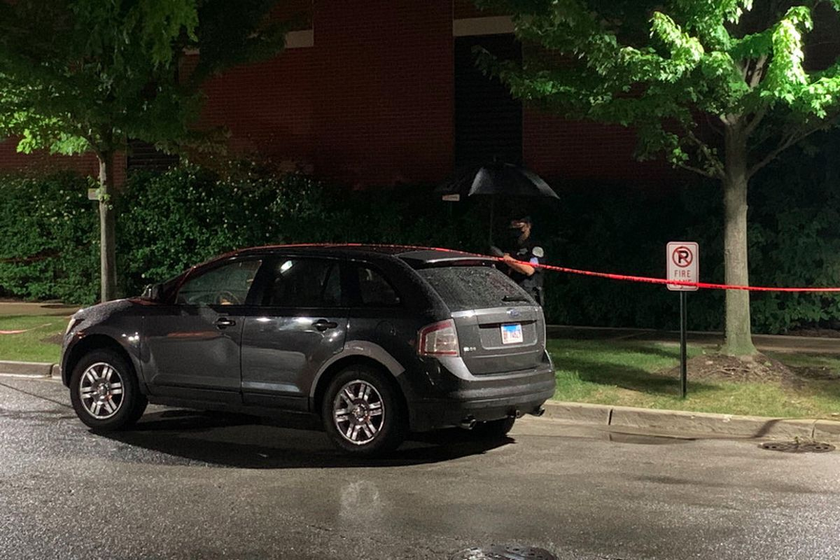 Chicago police use tape to block off an SUV outside West Suburban Medical Center in Oak Park that a 3-year-old boy was riding in when he was fatally shot Saturday, June 20, 2020, in Austin.