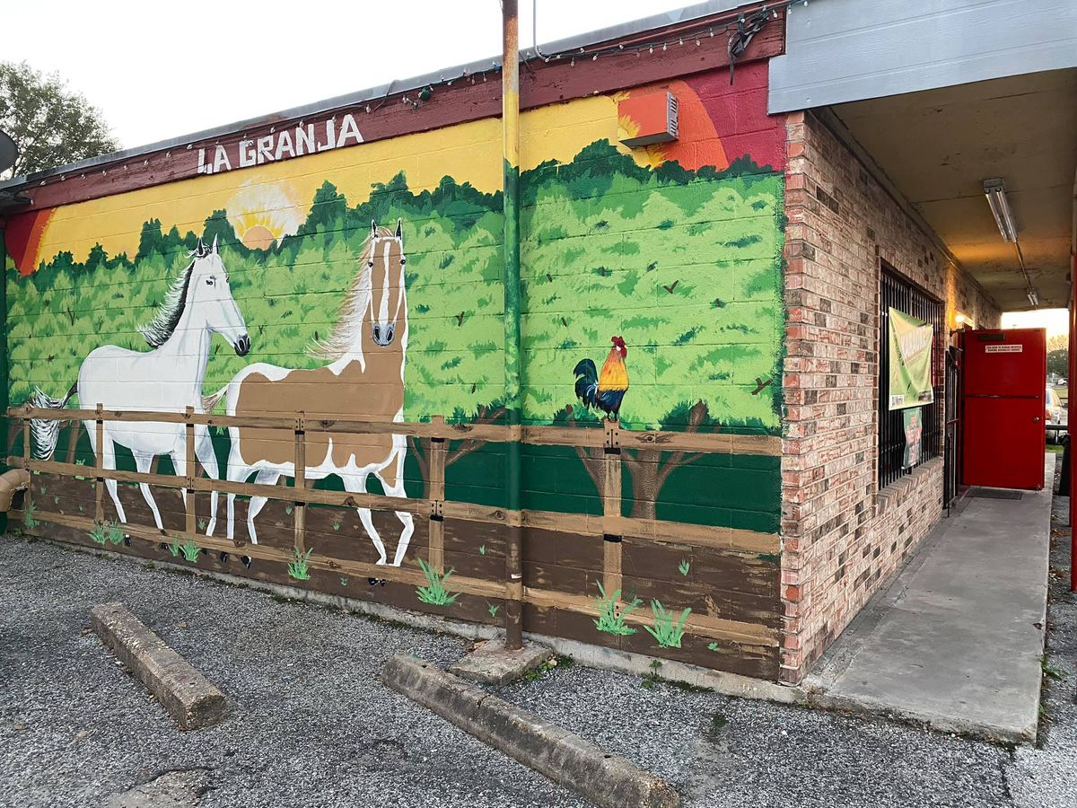a mural on the outside of a building depicting two horses in a fenced pasture and a rooster on the fence