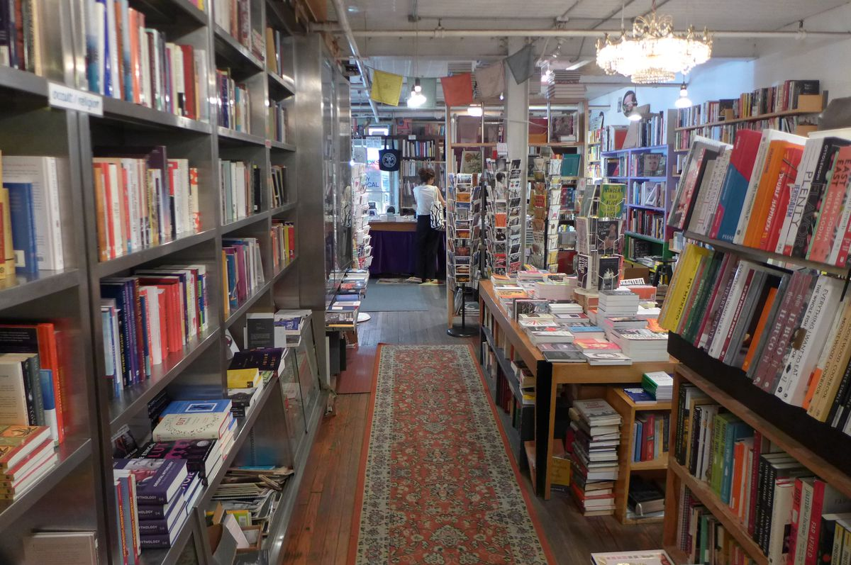 A room filled with books on all sides.