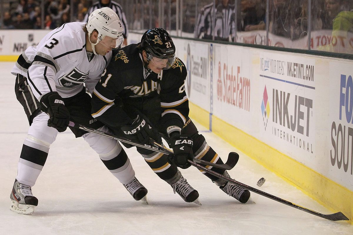 DALLAS, TX - FEBRUARY 12:  Loui Eriksson #21 of the Dallas Stars skates the puck against Jack Johnson #3 of the Los Angeles Kings at American Airlines Center on February 12, 2012 in Dallas, Texas.  (Photo by Ronald Martinez/Getty Images)