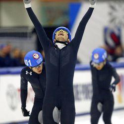John-Henry Krueger, center, celebrates after winning the men's 1000-meter A final during the U.S.Olympic short track speedskating trials Sunday, Dec. 17, 2017, in Kearns, Utah. (AP Photo/Rick Bowmer)