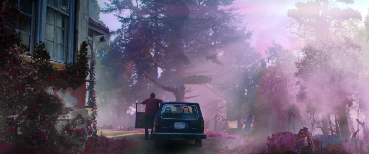 A still from Color Out of Space showing Nicolas Cage stepping out of a car into an otherworldly scene