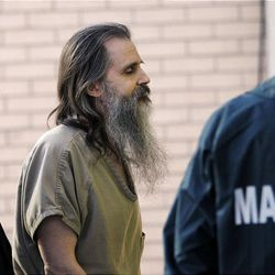 Brian David Mitchell, who is accused of kidnapping Elizabeth Smart, is escorted into federal court last month.