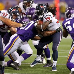 Aug 9, 2013; Minneapolis, MN, USA; Minnesota Vikings linebacker Audie Cole (57) tackles Houston Texans running back Deji Karim (39) in the third quarter at the Metrodome. The Texans won 27-13.