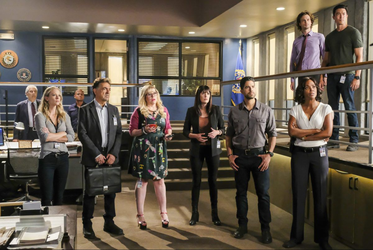 The cast of Criminal Minds stare pensively at something off-screen