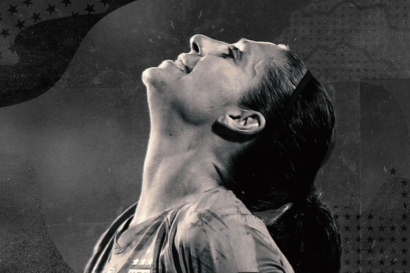 Sepia-toned photo of Carli Lloyd in profile looking up, exasperated.