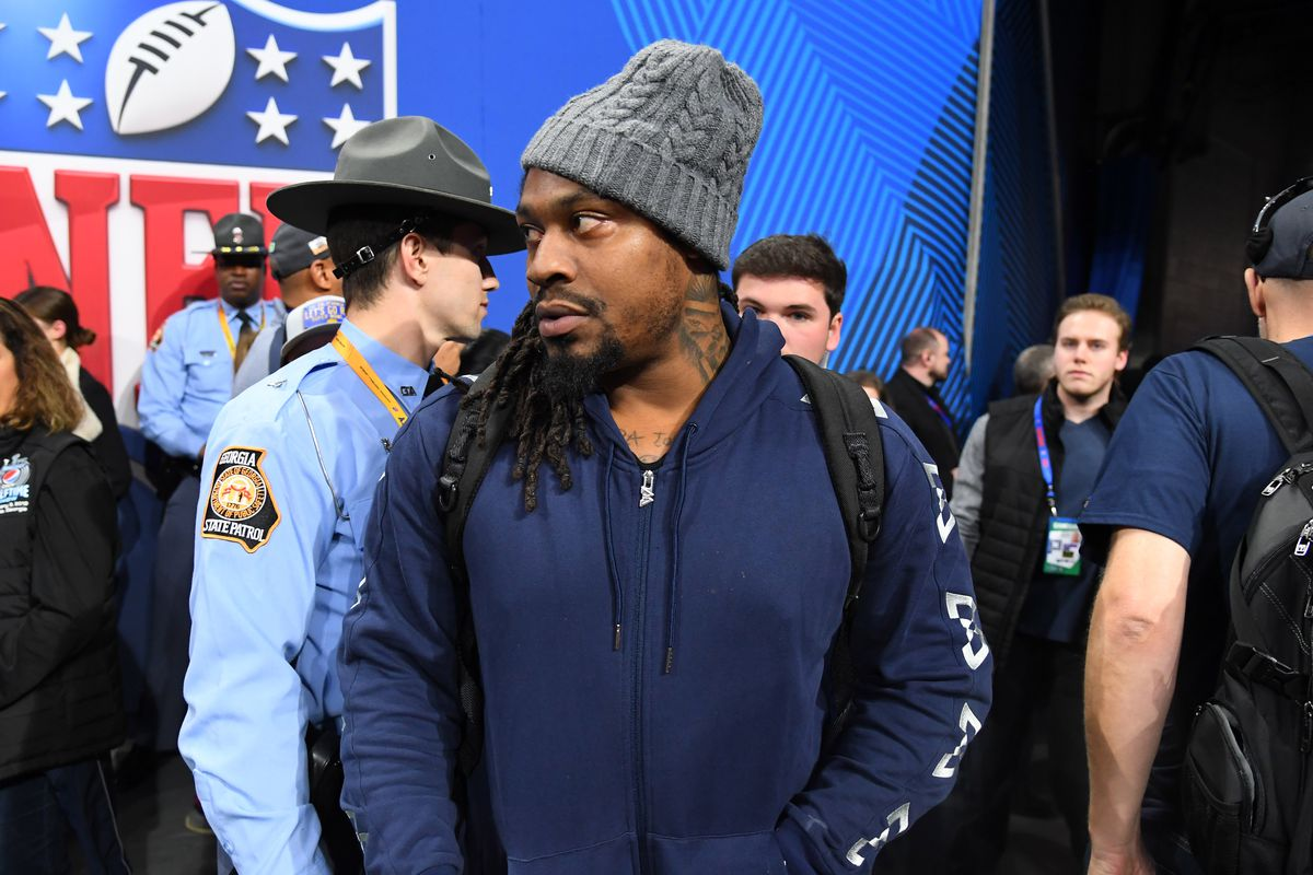 Oakland Raiders running back Marshawn Lynch on the sidelines before Super Bowl LIII between the New England Patriots and the Los Angeles Rams at Mercedes-Benz Stadium.