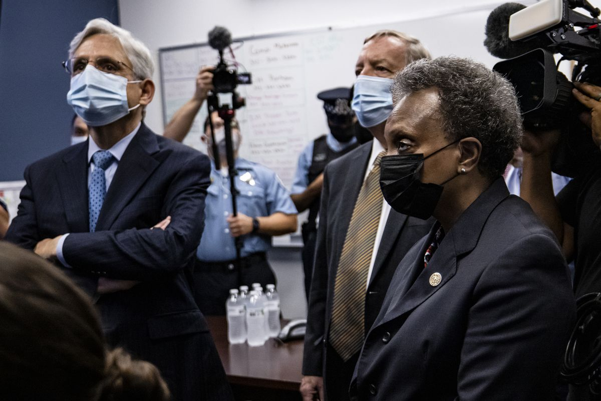 U.S. Attorney General Merrick Garland listens to a presentation alongside Sen. Dick Durbin (D-Ill.) and Chicago Mayor Lori Lightfoot while visiting the Chicago Police Department Strategic Decision Support Center on July 22, 2021 in Chicago, Illinois.