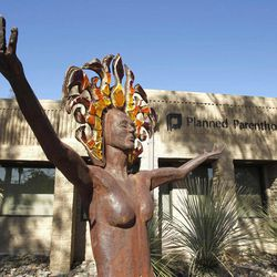 In this photo taken Sunday, Jan. 23, 2011, a statue representing women's empowerment stands in front of a Planned Parenthood facility in Tucson, Ariz.  Planned Parenthood, a perennial protest target because of its role in providing abortions, has notified the FBI that at least 12 of its health centers were visited recently by a man purporting to be a sex trafficker but who may instead be part of an attempted ruse to entrap clinic employees.
