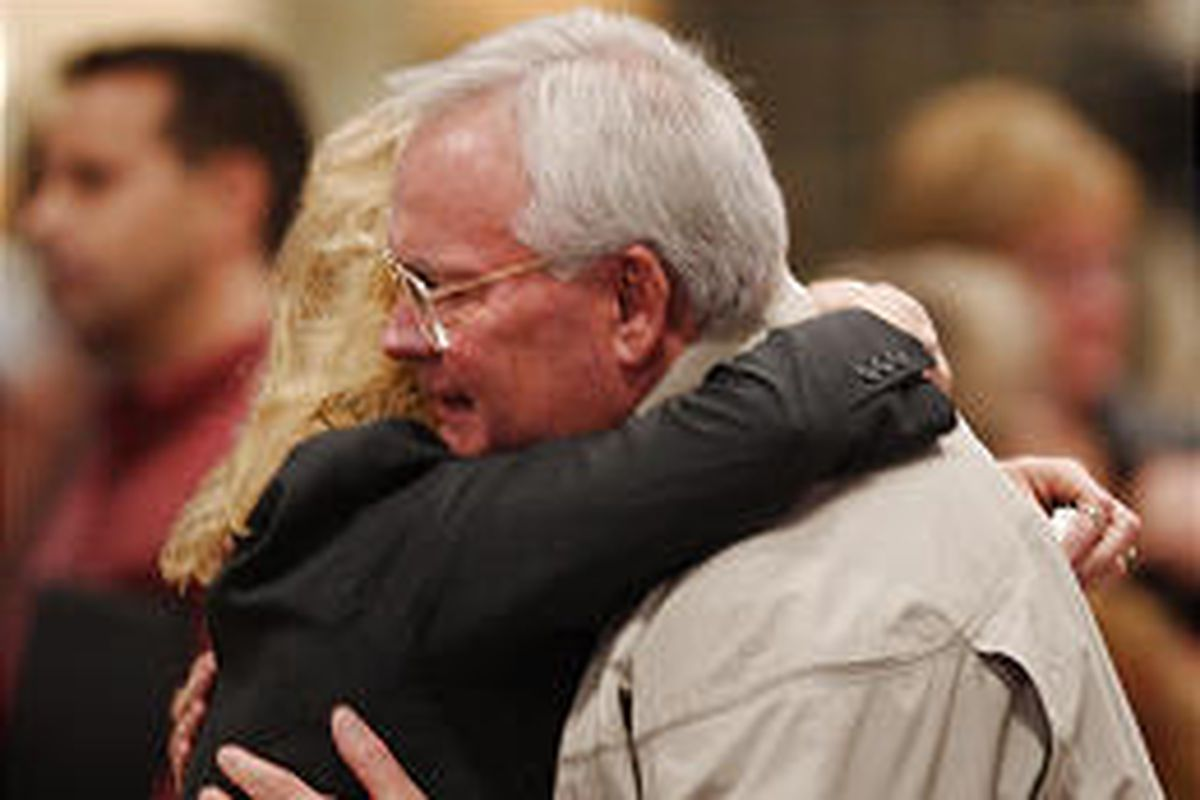 Brad Ator, father of crash victim Clark Ator, is comforted on Thursday by a well-wisher at a vigil in Kirksville, Mo. Clark Ator was an LDS bishop in Alpine, Utah.