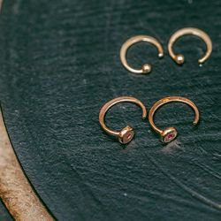 """<b>Melissa Joy Manning</b> 14kg Small Hoop Huggie Earrings, <a href=""""http://shopbird.com/product.php?productid=25452&cat=0&manufacturerid=184&page=1"""">$100</a> (back) and the 14kg Pink Flush Ruby Huggie Earrings (front), $200"""