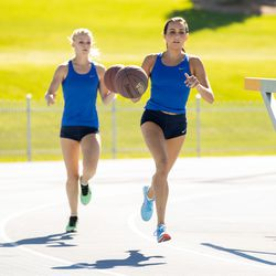BYU track athletes Whittni Orton, right, and Anna Camp-Bennett run a mile race while dribbling a basketball on Sept. 4. Orton crossed the finish line in 4:58.56, which converted to 4:52.71 with an altitude adjustment, shattering the world record. Camp-Bennett finished with a time of 5:10.37, which converted to 5:04.28.