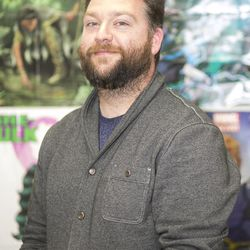 """High school teacher Eric Kallenborn is one of the founders of the Comic Education Outreach program that is partnered with Pop Culture Classroom, and poses for a portrait at Alan B. Shepard High School in Palos Heights, Illinois, on Tuesday, April 4, 2017. CEO aims to """"help educators successfully incorporate comics and graphic novels into their classrooms,"""" according to their mission statement."""