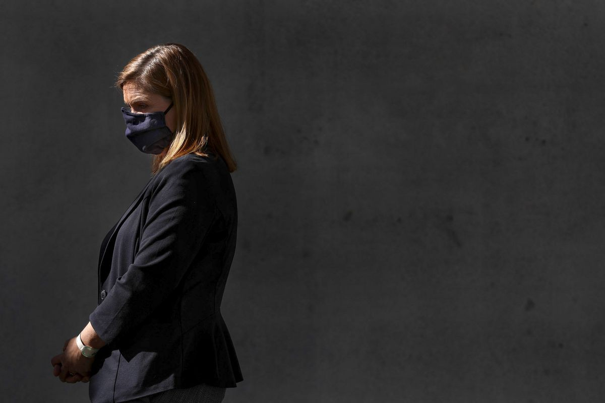 Salt Lake County Mayor Jenny Wilson wears a mask as Gary Edwards, health department executive director, discusses the county's phased reopening plan during a press conference at the county's Emergency Management Emergency Coordination Center in South Salt Lake on Wednesday, April 29, 2020.