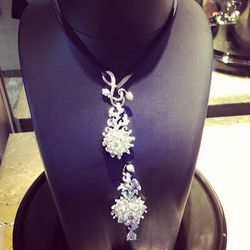This necklace can be worn in eight different ways. It's also an encyclopedia of different diamond cuts, representing pear, square, minor, princess cuts in one form or another.