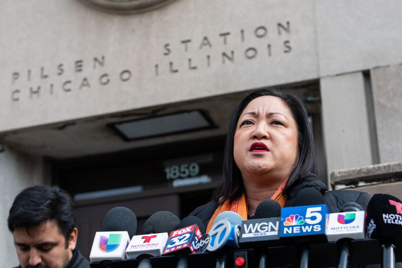 State Rep. Theresa Mah, D-Chicago, speaks to reporters outside the Post Office in Pilsen about allegations of discrimination against non-English speaking customers last year.