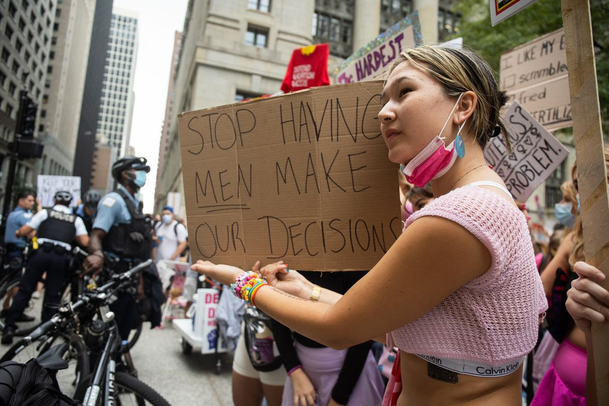 """An abortion advocate responds to pro-life protesters during the """"Defend Abortion Access"""" rally, which was organized by more than 20 organizations to oppose the near ban on abortions in Texas, at Daley Plaza in the Loop."""