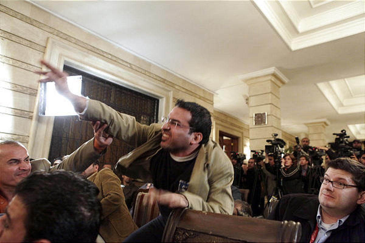 Iraqi journalist Muntadhar al-Zeidi throws a shoe at President George W. Bush during a new conference in Baghdad on Dec. 14, 2008.