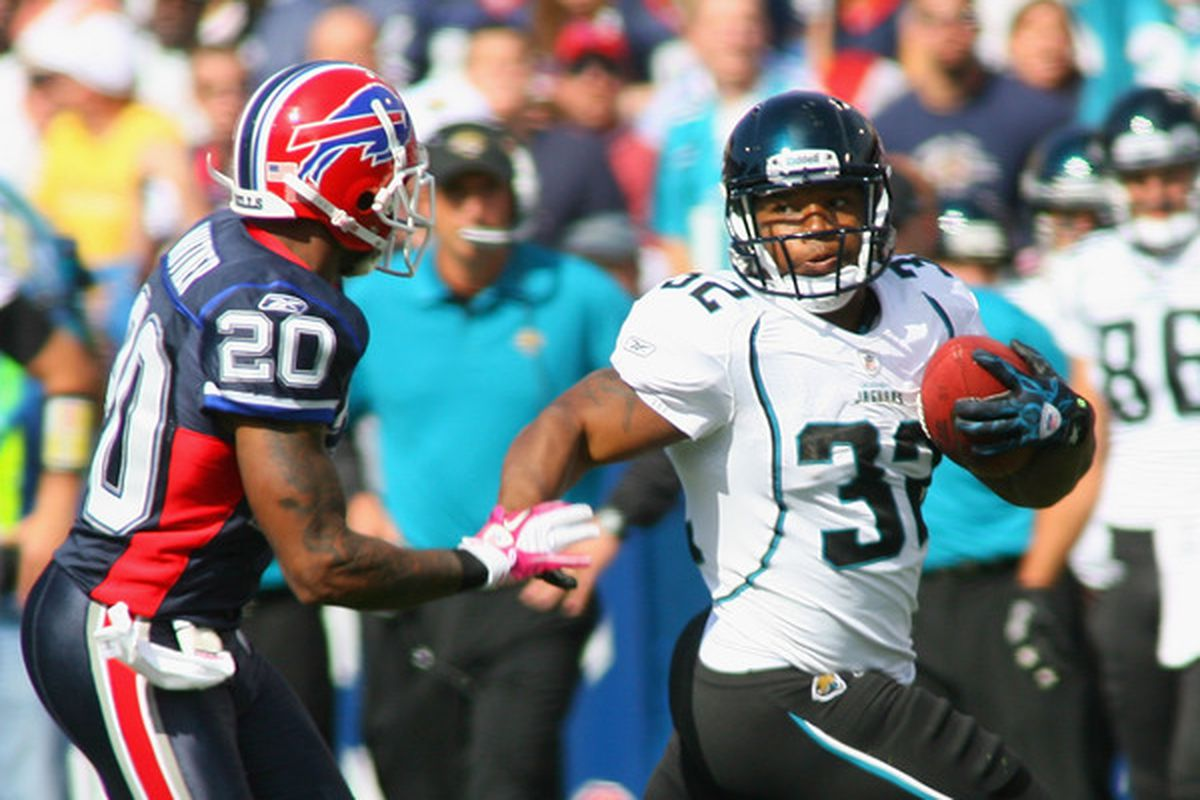 ORCHARD PARK, NY - OCTOBER 10:  Maurice Jones -Drew #32  of the Jacksonville Jaguars runs past Donte Whitner #20 of the Buffalo Bills at Ralph Wilson Stadium on October 10, 2010 in Orchard Park, New York.  (Photo by Rick Stewart/Getty Images)