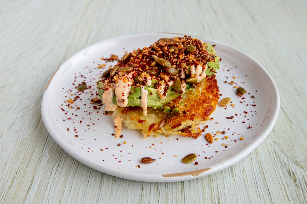 An avocado toast with smoked paprika aioli, quinoa crunch, and Aleppo pepper from Lenni