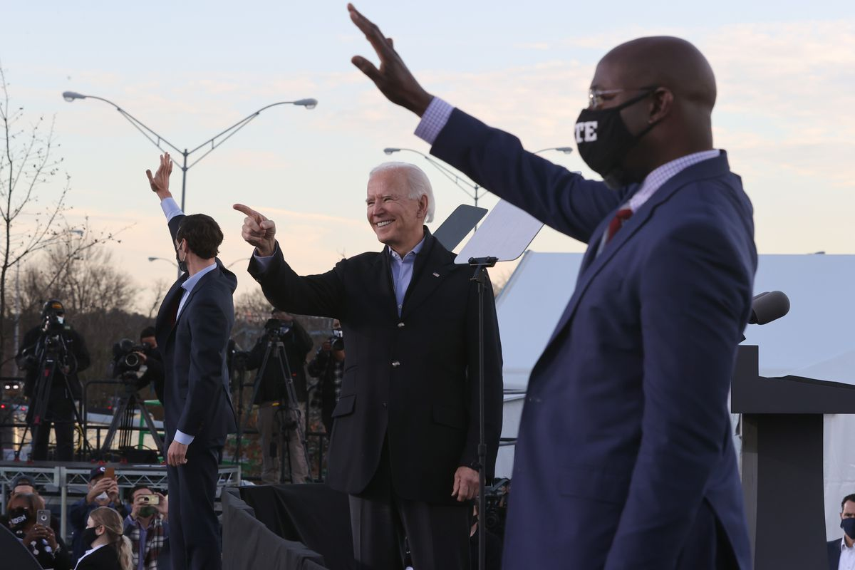 President-elect Joe Biden along with democratic candidates for the U.S. Senate Jon Ossoff and Rev. Raphael Warnock greet supporters during a campaign rally the day before their runoff election in the parking lot of Centerparc Stadium January 04, 2021 in Atlanta, Georgia.