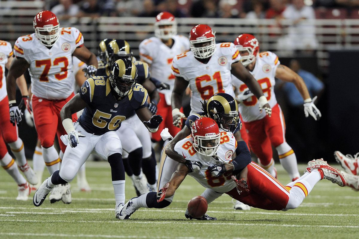 August 18, 2012; St. Louis, MO, USA; St. Louis Rams cornerback Janoris Jenkins (21) forces a fumble from Kansas City Chiefs wide receiver Jon Baldwin (89) in the first half at the Edward Jones Dome. Mandatory Credit: Jeff Curry-US PRESSWIRE