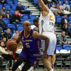Los Angeles D-Fenders guard Julian Jacobs (5) drives around Salt Lake City Stars forward JJ O'Brien (22) at the Lifetime Activities Center in Taylorsville on Wednesday, Feb. 08, 2017.