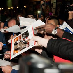 """Republican presidential candidate Mitt Romney signs autographs after taping an episode of the """"Late Show with David Letterman,"""" in New York, Monday, Dec. 19, 2011."""
