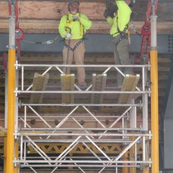 11:32 a.m. Crew work on removing boards from under the left-field bleachers -