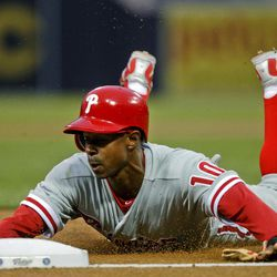 Philadelphia Phillies' Juan Pierre slides into third head first as he takes an extra base on an error by San Diego Padres left fielder Will Venable during the first inning of a baseball game Thursday, April 19, 2012, in San Diego.